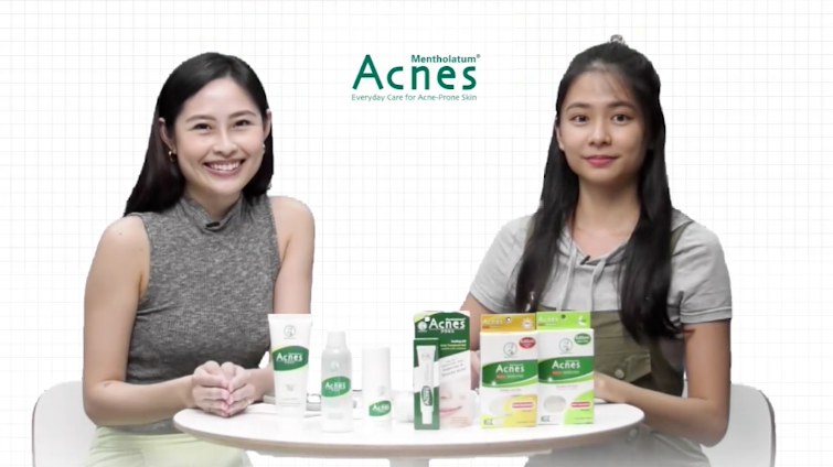 Two presenters sitting at a table with skincare products by Acnes