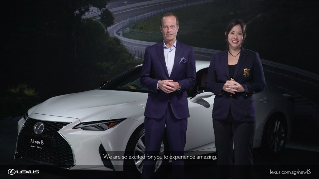 Two hosts in front of the new Lexus IS during the official car launch live stream
