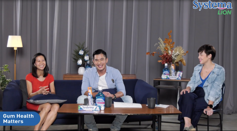 A screenshot of the three hosts smiling at the camera