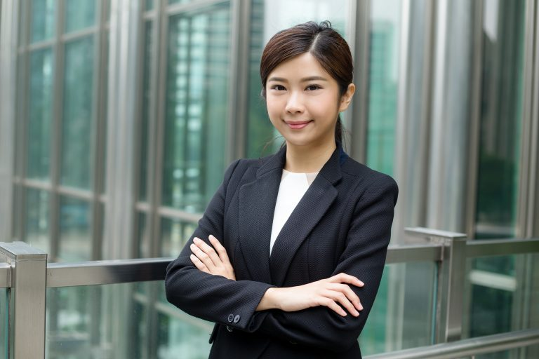 Asian businesswoman with her arms folded
