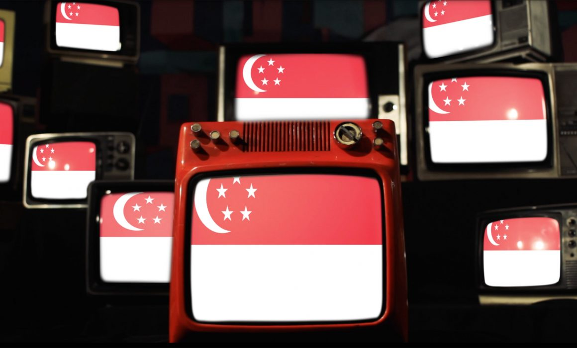 Multiple television screens showing the Singapore flag.