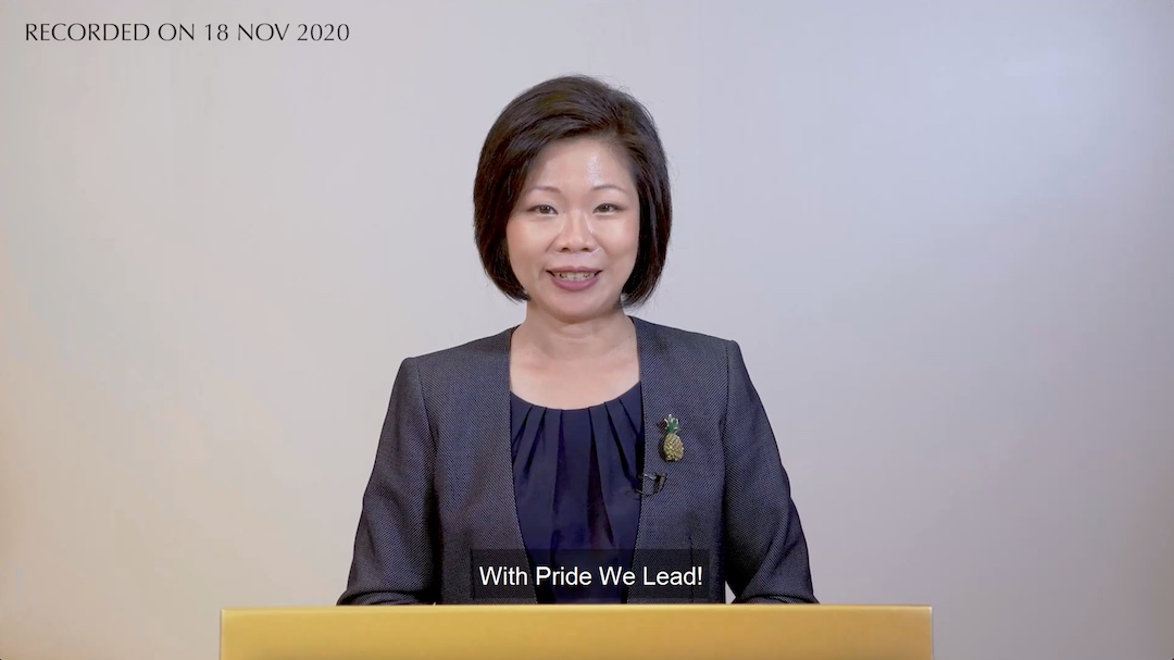 Minister Sim Ann looking into the camera while giving her speech.